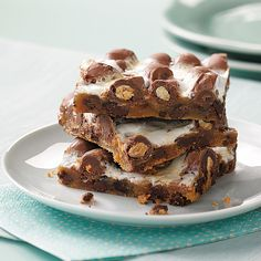 Gooey Chocolate-Peanut Bars Recipe -These are so easy to make and take no time at all. They're great to package up for those college kids looking for something from home. Everyone will want this recipe. —Elaine Grimme, Sioux Falls, South Dakota