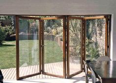 Wooden Bi Folding Patio Doors -- these open frames are so lovely. And the answer is yes! I want to do the doors as you described w/ the window crack to the right for the kitties. Wooden Bifold Doors, Wooden Patio Doors, Folding Patio Doors, French Doors Patio, Sliding Glass Door, Wood Doors, Exterior Sliding Doors, Bifold French Doors, Steel Doors