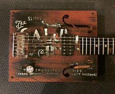 6 string electric cigar box guitar made by Michael Ballerini in a Boulevard beer theme.