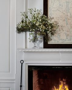 "Ralph Lauren Home (@ralphlaurenhome) on Instagram: ""A wild arrangement in a classic #ralphlaurenhome vase"" - gorgeous fireplace mantel and mouldings"
