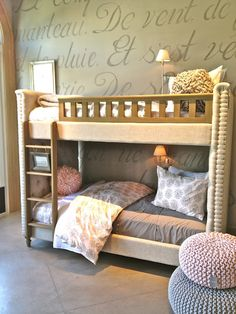 Never seen an upholstered bunk bed before and this one looks great. Love the styling of this room.