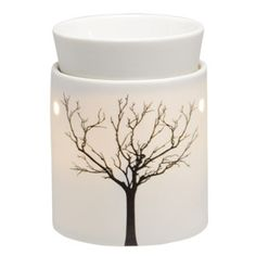 The simple, modern shape and glowing porcelain of Tilia allows the stark beauty of a tree in winter to shine through.