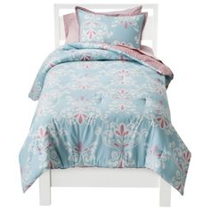 Comforter from Target (looks reversible). May be too heavy for Lexi. A light coverlet or quilt is what she is used to.