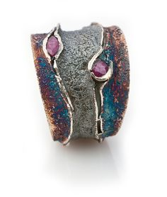 Elisenda De Haro. 'Reef'. Oxidized silver and rubies.