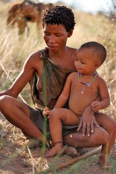 Africa | San mother and child. Botswana