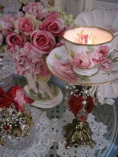 tea  cup n saucer glued to a candle stick,add fringe to saucer for more glitz, add candle or use to hold jewelry or change or whatever. hmm.