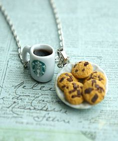 This necklace features a miniature plate of handmade chocolate chip cookies sculpted from polymer clay along with a Starbucks coffee cup charm. Both charms hang on a silver tone chain necklace that me