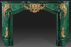 Fireplace mantle covered with malachite veneer and ormulu decorations.
