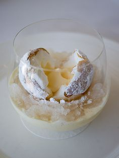 ... white nectarine ice cream encased inside soft white meringue, all