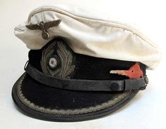 Reproduction German U-Boat Submarine Captains Peaked cap with 70+ years of ageing and numerous light oil stains and some lightly worn and tarnished areas as worn by the Captain of U-96 Heinrich Lehmann-Willenbrock.    www.warhats.com