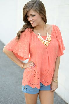 """FESTIVAL ALERT! This coral cutie is perfect for any outdoor music festivals on your calendar this summer! We love how the cape sleeves flow over the shoulders! The color is a little lighter in some areas because of the distressed, bleached style that's so hot right now! This loose-fitting top is great for anyone putting together a Boho-chic outfit! :) Fits true to size. Miranda is wearing the small.  Shoulder to hem: S - 24"""" M - 25"""" L - 26"""""""