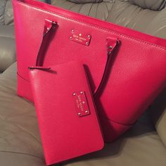 KS huge tote & travel wallet Beautiful red leather tote and travel wallet set.  Only used for the last week, maybe 2.  No stains, still smells like that new leather!  Everywhere I go someone always complements this bag! kate spade Bags Totes
