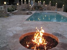 Warming by the natural gas fire pit at night after a day in the fabulous pool by aspools, via Flickr