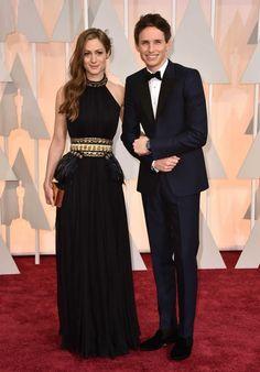 87th Academy Awards: Oscars 2015 red carpet : Hannah Bagshawe and Eddie Redmayne in a Alexander McQueen bespoke navy tuxedo