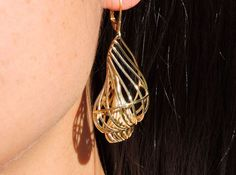 Designs by Bachman. Metal Polished Brass  Polished Bronze  Polished Brass Pure brass that's hand-polished to a fine sheen. $75.00 Matching oppositely oriented earrings, inspired by a mixture of Mathematics and Nature. You need to add ear hooks (available from any craft or bead store) yourself.