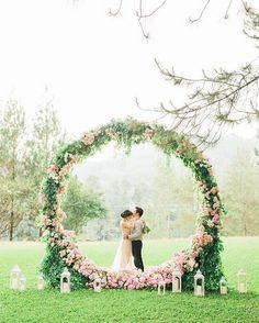 A wedding backdrop that frames rather than hides a venue's beautiful surrounds! This floral wreath is what dreams are made of! {Facebook and Instagram: The Wedding Scoop}
