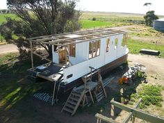 Houseboat building and Shantyboat building goes on everywhere. In Australia one couple is building a Shantyboat to cruise and explore the Murray River.