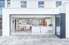 A two-story addition livens up a staid house in southern England.