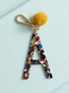 Shop Acetate Pom Monogram Keychain - A at Altar'd State. This multi-color acetate keychain is perfect for clipping on your handbag or wallet! Diy Keyring, Keychain Clip, Monogram Keychain, Cute Keychain, Keychain Ideas, Creeper Minecraft, Ace Tate, Embroidery Designs, Cute Car Accessories