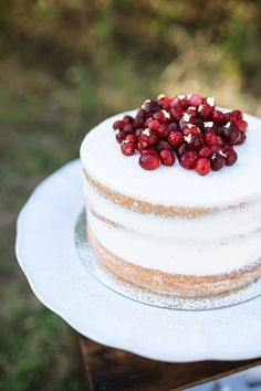 Cherry-filled tres leche cake topped with gold-leafed cranberries | Photo by Smith House Photography | Cake design by Whisk Bakery