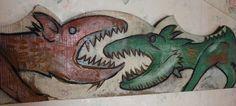 Franca discussione fra draghi incazzati .Legno inciso e dipinto (da appendere in soggiorno per favorire il dialogo fra coniugi)