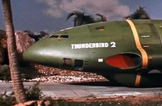 Thunderbird 2 Type 6 - early version with small '2' - suggests the launch sequence was shot earlier,then they realised that the '2' should be easier to read on screen. This has the white square in front of the intakes like type 3, but it has more symmetrical intakes - has 4 black dots next no rear lower window - 'Thunderbird' is slightly lower towards the front