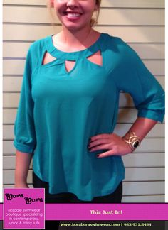 Show a little skin in the fall with this teal top with cutouts. This color is paired perfect with gold accents.