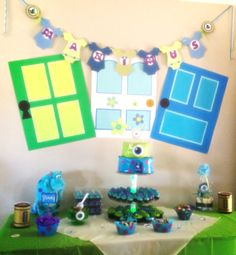 My sons Monsters Inc. baby shower. Baby banner & scream canisters, compliments of the talented and amazing Jamie at: http://mycraftyways.com.