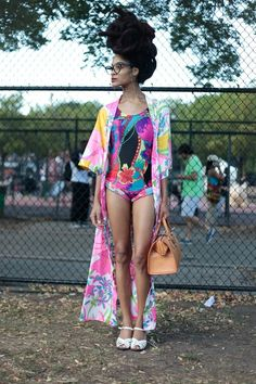 #Afropunk StreetStyle: A gorgeous crown of locks topped this eclectic ensemble, comprised of a printed one piece and a vintage floor length jacket.