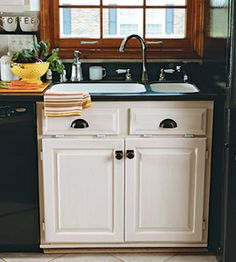 Image result for white cabinets with black knobs