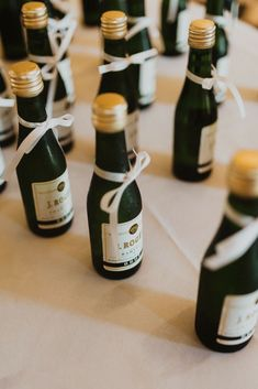 These mini champagne wedding favors are featured in a real wedding from Hartford, CT. These are fun wedding favors for any wedding. Head to our website for more wedding ideas! Personalize your wedding and put a spin on tradition with The Knot's customizable wedding websites, wedding invitations, registry (and more!). Not sure where to start? Get ideas and advice from our editors on everything from wedding colors and venue types to all things guest. Champagne Wedding Favors, Mini Champagne, Best Wedding Favors, Fall Wedding Invitations, Wedding Ideas, Wedding Inspiration, The Wedding Date, Our Wedding, Wedding Agenda