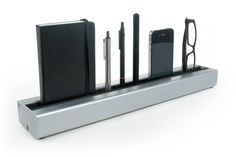 Desk Rail: Tucked behind your keyboard, the Desk Rail lets you quickly switch from one tool to the next with a contained, natural movement. This is especially helpful for Wacom tablet users. The size, angle, and padding material in the channel have all be carefully designed and tested to provide a soft landing, making it easy to drop off an item without looking down.