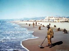 Engineers of the (Negro) Division tape cleared paths through the heavily mined beach at Viareggo, Italy. Germans, fearing invasion from. Pictures Of Soldiers, Heart Of America, Ww2 Photos, Us Marines, Our World, Us Army, Colorful Pictures, World War Ii, Troops