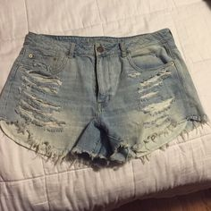Shorts Hi-rise festival shorts. Never worn, torn on the front. American Eagle Outfitters Shorts Jean Shorts