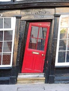 This crooked door in Canterbury looks like it's straight out of Harry Potter!  We love the unique entrance to the Old King's School Shop in Canterbury, England!