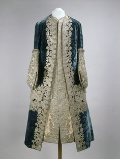 """1727-1730 French Coat and waistcoat worn by Tsar Peter II at the Moscow Kremlin Museums - """"In this ensemble the silk of the waistcoat and coat cuffs has faded considerably. It was once a vibrant pink, an elegant contrast to the deep blue velvet of the coat. Both garments are decorated in silver embroidery, worked separately then applied to the velvet and taffeta, rather than embroidered directly onto the coat and waistcoat."""""""