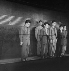 Men in police line up wearing zoot suits. January 01, 1942
