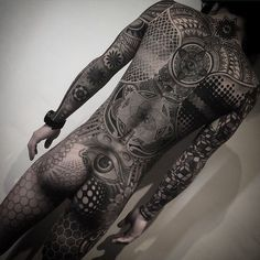 Amazing geometric B&G full body suit with a rubik's cube themed sleeve by @nissaco