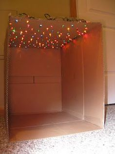 """""""star"""" box with Christmas lights - could transform to a reading nook."""