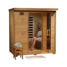 Hanko 4 Person PreBuilt FAR Infrared Sauna  Quality Hemlock Construction for a Luxurious Spa Experience  9 Premium InfraWave Carbon Composite Heaters  Built In MP3AUXCDFM Stereo with Speakers  7 Color Therapy Light  Backrests Robe Hooks and Magazine Rack  5 Year Warranty  Easy 2 Person Construction -- Locate the offer simply by clicking the VISIT button