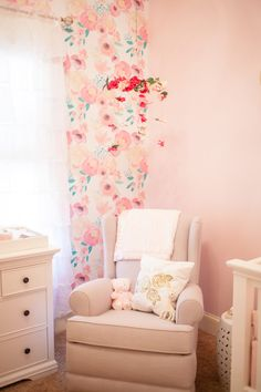 Great idea to put a mobile over your nursing chair! Secret garden themed nursery. #nursery #babygirlnursery