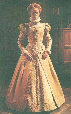 BBC Queen Elizabeth costume 1    Very detailed costume worn by Glenda Jackson as Queen Elizabeth I in the 1970 BBC TV series 'Elizabeth R'.    Gown is cream matte satin with braid and embroidery. Underskirt and sleeves in a complementary fabric, possibly curtain material. Fantastic upper bodice, neckline and sleeves