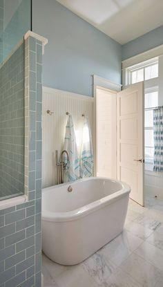 blue and white  bathroom with soaking tub