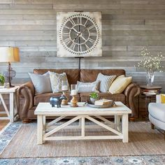A Farmhouse Living Room That Will Make You Want A Brown Sofa. A light and airy look with a brown sofa, warm white tables, mix of textures and gray rustic wood wall. Brown Leather Furniture, Distressed Leather Sofa, Leather Rugs, Leather Wall, Leather Chairs, Brown Couch Living Room, Living Rooms, Family Rooms, Apartment Living