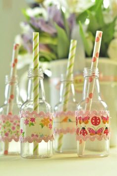 Wrap glass bottles with scrapbook paper and ric rac, then add paper straws for a perfect touch at a garden or princess party! Found via Kara's Party Ideas #butterfly #planning #garden #party #birthday #decorations #supplies #ideas