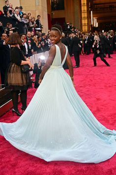 Oscar winner Lupita Nyong's has her Cinderella moment in a pastel blue, pleated custom Prada gown with plunging neckline and Fred Leighton jewels. The Oscars Red Carpet 2014 - Pictures from 2014 Academy Awards Red Carpet - Harper's BAZAAR