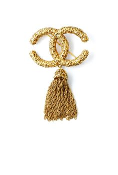 Chanel Vintage Textured Chanel Motif Tassel Brooch  | More here: http://mylusciouslife.com/photo-galleries/bling-fling/