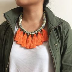 Adjustable leather, cotton, & vintage fabric necklace // ethiopian brass beads // silk tassels // braided leather // chain clasp We took our more casual Cleo Necklace and stepped it up a bit. The Laur