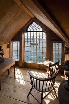 Oh heaven, a writing desk tucked under the eaves with a view of the sea.