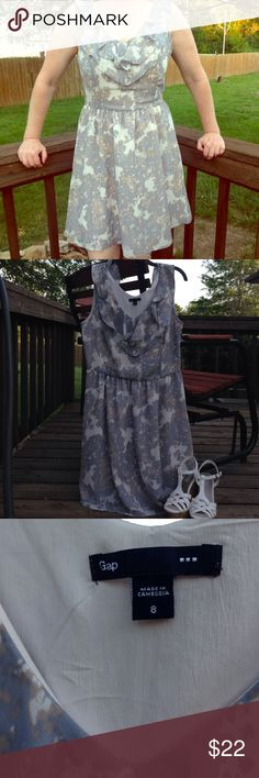 NWOT Gap dress Never worn Gap dress Size 8. Blue/gray tan and off white. 100% polyester. Almost knee length. Model is a size 4 GAP Dresses Midi